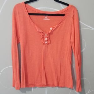 Orange long sleeved shirt